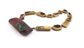 ViT-O6 Brooch Necklace   broken skateboards. blood wood. cement. brass. sterling silver. stainless steel.
